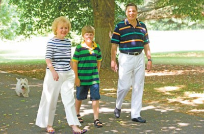 Ambassador of the Russian Federation Yuri Ushakov, his wife Svetlana and grandson Misha, followed by dog Simon, stroll the lushly planted grounds of the Eastern Shore dacha.