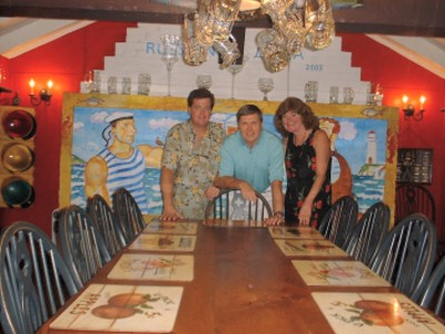 Brian and Linda Bigham Pose With Russain Ambassador Yuri Ushakov With His Custom Made To Order Farm Table